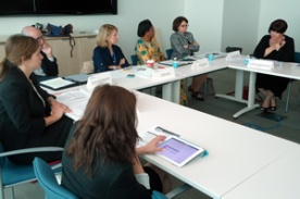 participants_in_women_in_diplomacy_workshop_sitting_at_the_table
