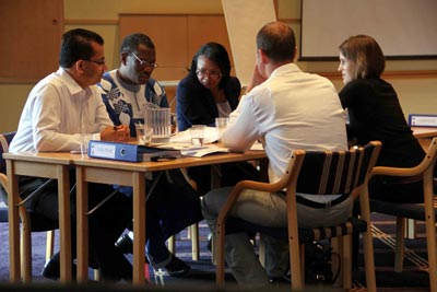 Participants engage in negotiation practice