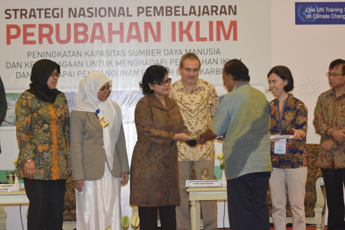 Dr Rachmat Witoelar formally hands over copies of Indonesia's National Climate Change Learning Strategy to sector ministries, witnessed by Ambassador Walker-Nederkoorn of Switzerland