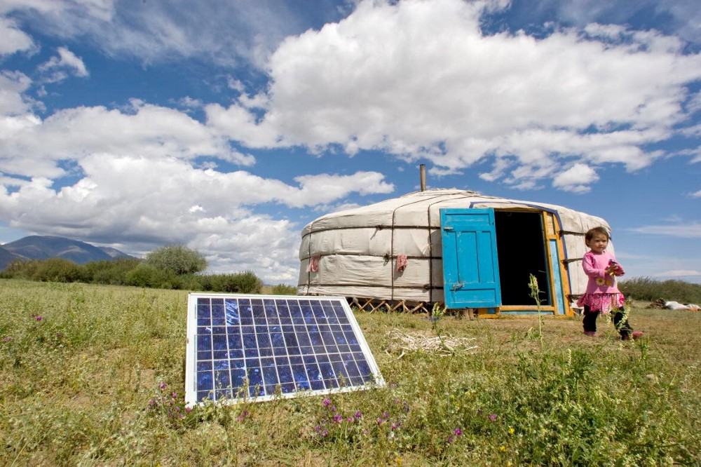 A family in Tarialan, Uvs Province, Mongolia, uses a solar panel to generate power for their ger, a traditional Mongolian tent. UN Photo/Eskinder Debebe