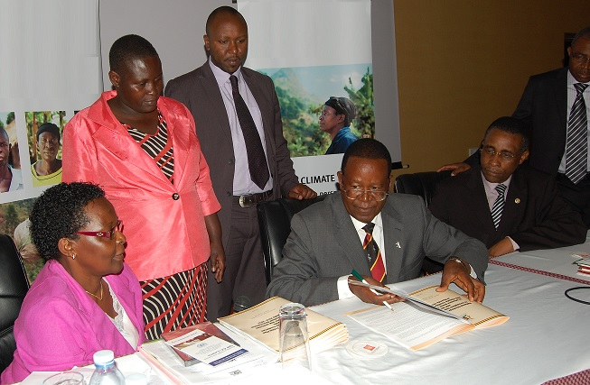 The Minister signing the Strategy.