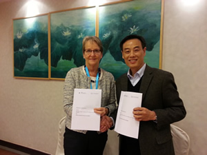 Ms. Sally Fegan-Wyles, Acting Head and Executive Director, UNITAR, with Professor Zhang, Executive Director of the Center for UN Studies, Fudan University