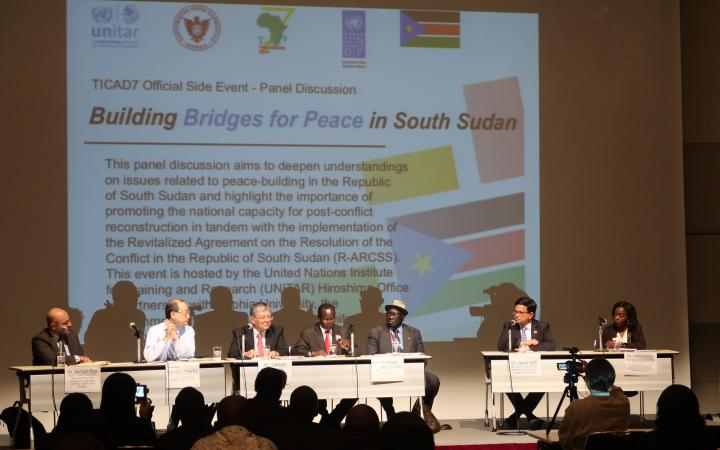 Panelists present on stage during the session