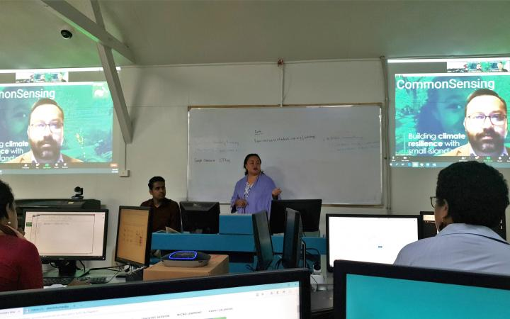 Training facilitator connecting from Bangkok, supported by the in-country expert, interacting with the participants in Suva, Fiji.