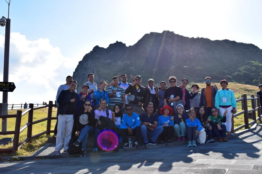 Participants at Sunrise Peak, one of UNESCO heritages worldwide