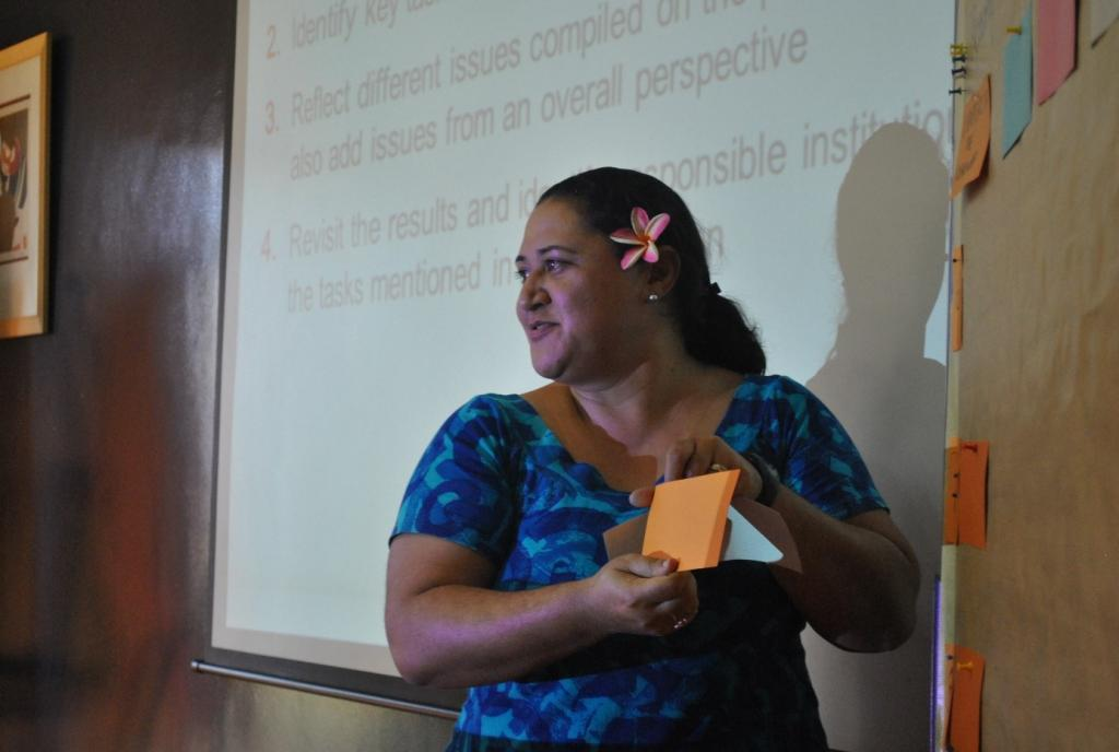"Photo 6: One of the trainees from Samoa performs a ""trainers on stage"" session summarizing the main findings of group matrix exercises on specific NAP country situations."