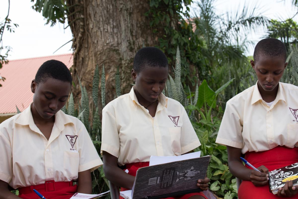 Pupils at Trinity College Nabbingo in Uganda prepare questions on climate change ahead of their Youth Climate Dialogue with students in France (Photo: UNITAR)