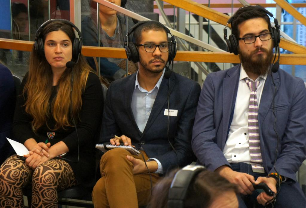 Participants focus on listening to the classroom via professional sound-proof headsets.