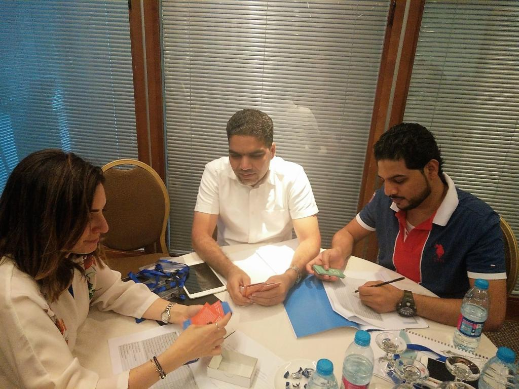 Photo 2: Participants from Lebanon and Oman testing the Skills Assessment cards.