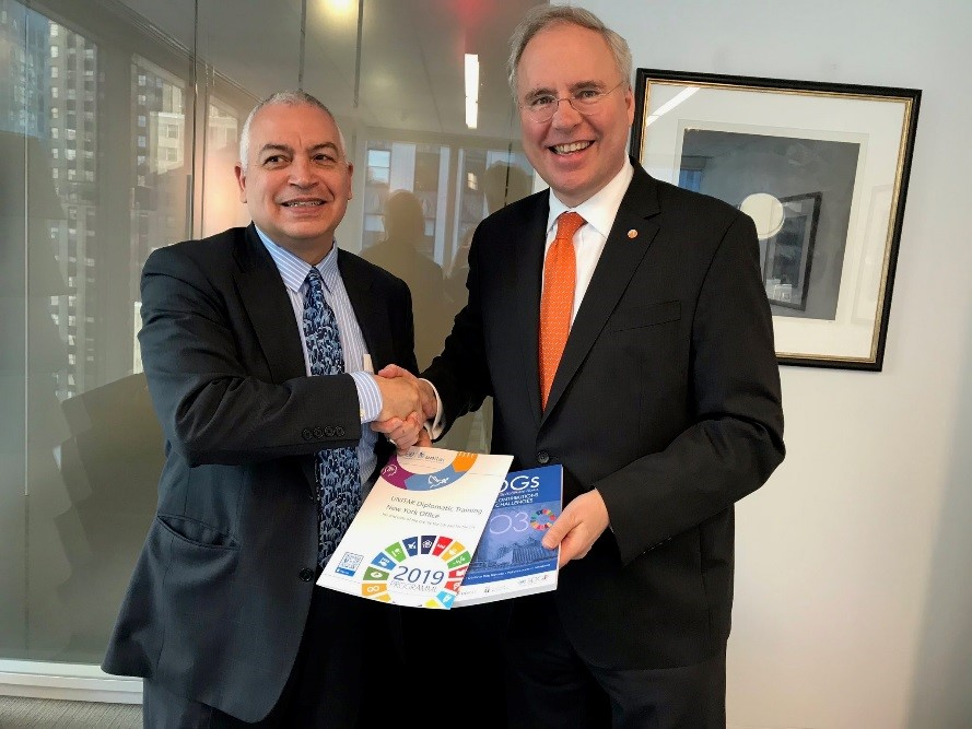 Head of Office UNITAR NYO, Mr. Marco Suazo handing 2019 UNITAR Catalogue and recent publication to H.E. Mr. Karel Jan Gustaaf van Oosterom, Permanent Representative of Netherlands to the UN. Photo credit: UNITAR NYO