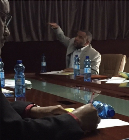 Ethiopia Environment Minister Ato Kare Debessa looks on as Ministry of Education official outlines climate change priorities.
